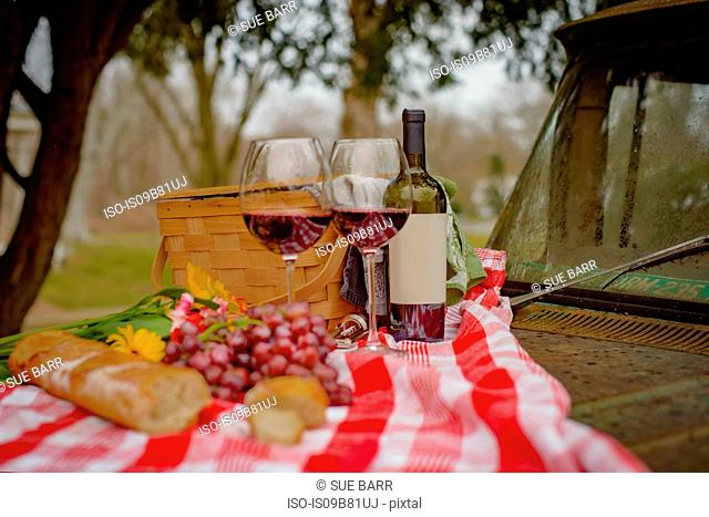 Picnic food for two on car bonnet