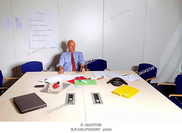 Businessman sitting at conference desk