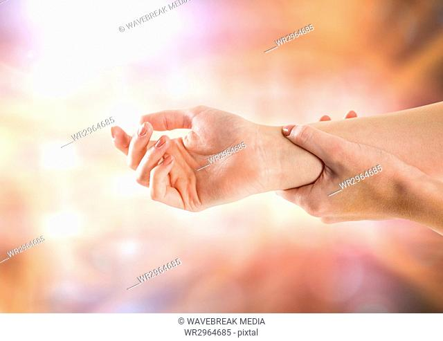 Hand restraining arm with sparkling light bokeh background
