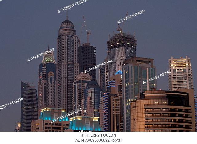 Skyscrapers illuminated at twilight, Dubai, United Arab Emirates