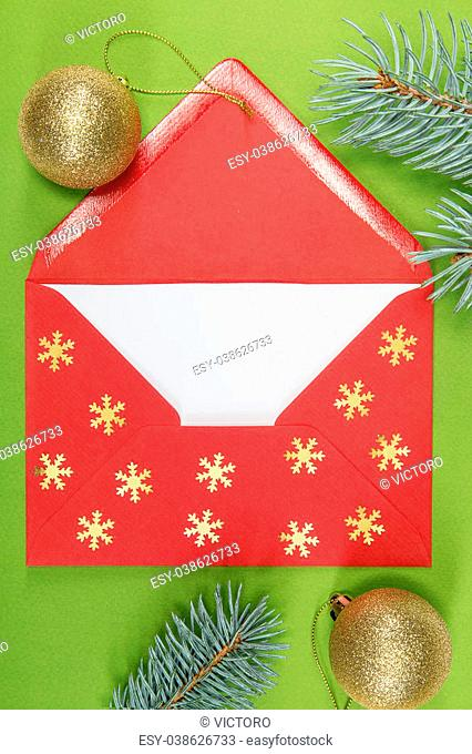 red envelope on green background and chritmas ball, christmastime