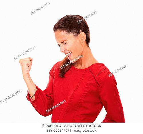Portrait of satisfied latin woman celebrating her victory with her eyes closed on isolated studio