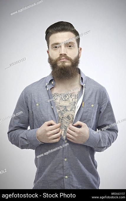 Portrait of mid adult man with tatoos