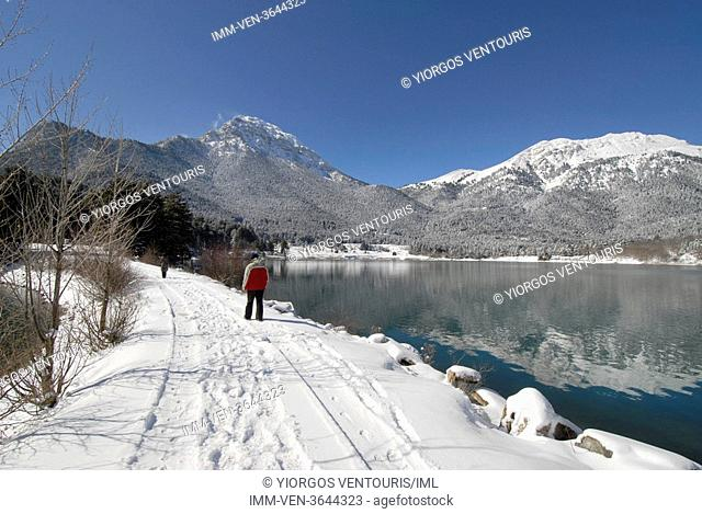 People walking by Doxa Lake. Doxa Laka, Feneo, Corinthia, Peloponnese, Greece