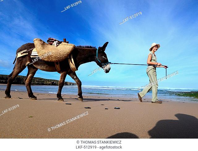 Donkey hiking along the beach of Aljezur with Sofia von Mentzingen and donkey Mocca, Costa Vicentina, Algarve, Portugal