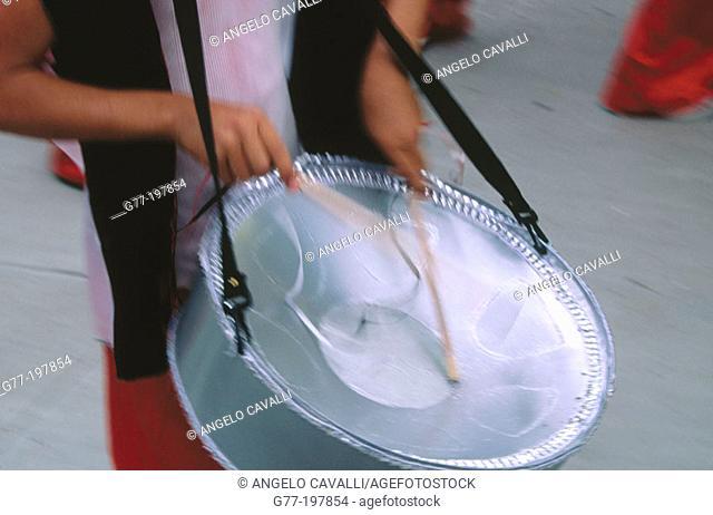 Playing steel pan during carnival. Trinidad and Tobago
