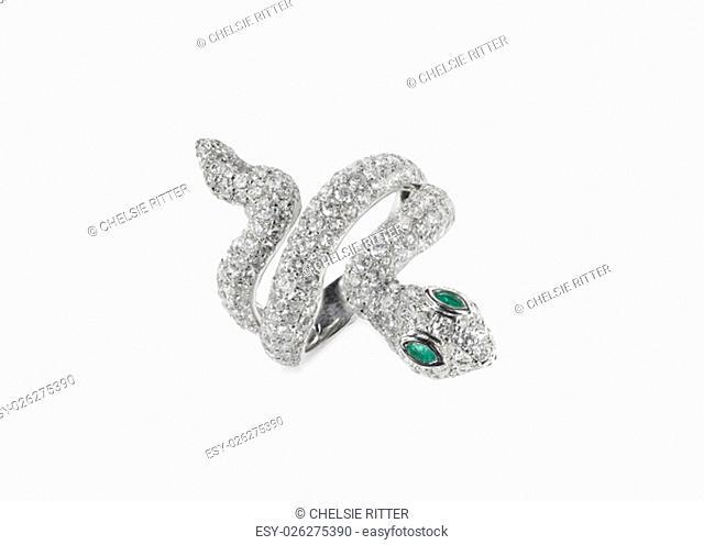 diamond snake ring with emerald eyes isolated on white