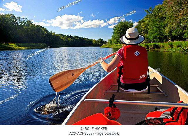 Paddling a canoe on the Mersey River in Kejimkujik National Park and National Historic Site of Canada, Nova Scotia, Canada