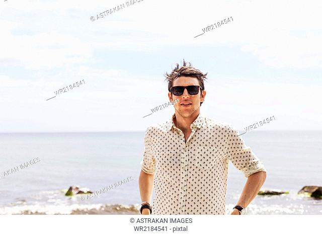 Close-up of man standing against sea
