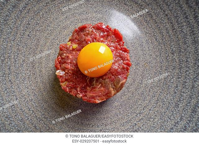 Steak Tartare raw meat recipe with egg yolk modern cuisine