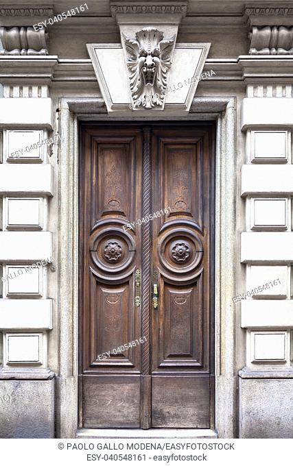 Italy, Turin. This city is famous to be a corner of two global magical triangles. This old door has been guarded by a gargoyle in last hundred years