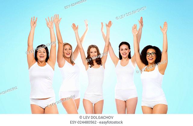 happiness, friendship, beauty, body positive and people concept - group of happy different women in white underwear with raised arms celebrating victory over...
