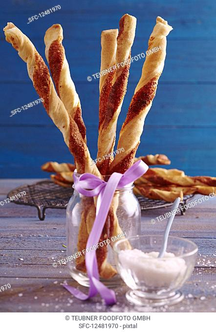 Spicy yeast dough and puff pastry Parmesan sticks in a glass
