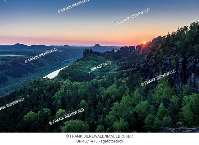 Landscape with rock formations, trees and cloudy blue sky, Saxon Switzerland National Park, River Elbe behind, Bad Schandau, Saxony, Germany
