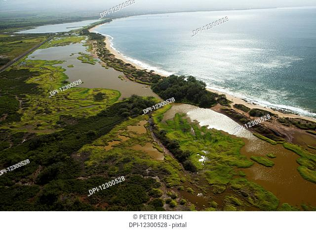 Aerial view of Kealia Pond National Wildlife Refuge and brackish ponds, home to endangered Hawaiian Birds; Maui, Hawaii, United States of America