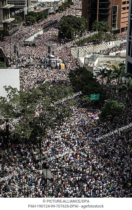 FILED - 23 January 2019, Venezuela, Caracas: Photo made available on 24.01.2019 - A huge crowd gathered on 23.01.2019 to protest against the government of...
