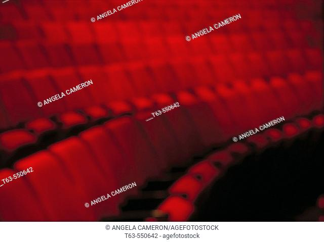 Red theatre seats in rows