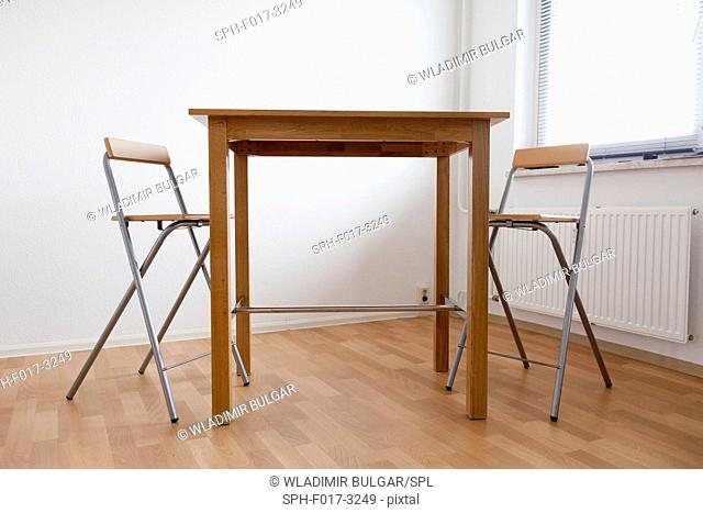 Empty table and chairs in a room
