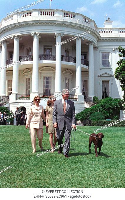President Bill Clinton, Hillary and Chelsea Clinton, and Buddy the Dog on the South Lawn. July 24, 1998. (BSLOC-2015-2-206)