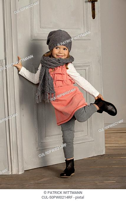 Smiling girl wearing hat and scarf
