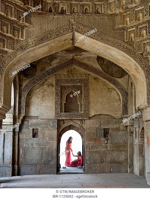 Bara Gumbad, Silhouettes of young Indian women in a door, Lodi Gardens, Delhi, India