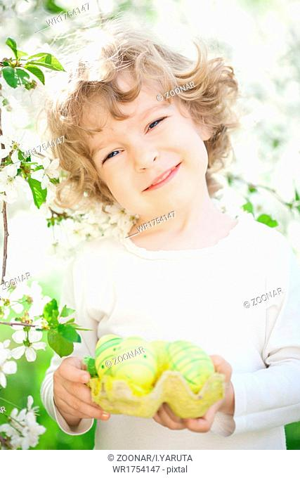 Child holding Easter eggs