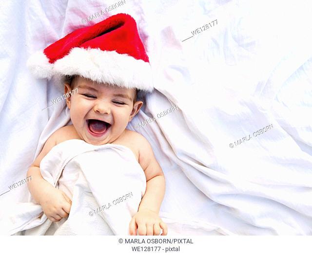 Happy baby in a Santa hat
