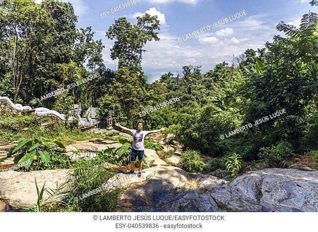 Boy at jungle in Wat Pha Lat Chiang Mai Thailand