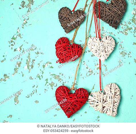 wicker hearts on a green background, empty space