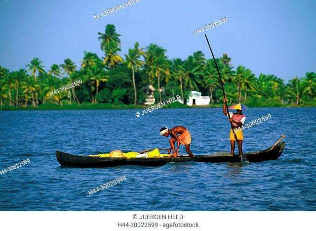 India Kerala indian on a small boat in backwaters