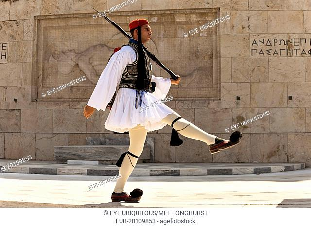 Greek soldier, Evzone, marching beside Tomb of the Unknown Soldier, outside Parliament building
