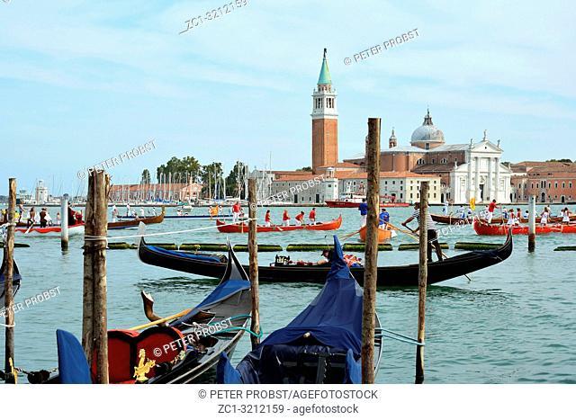 Historical boats parade befor the Island of San Giorgio Maggiore in the Lagoon of Venice - Italy