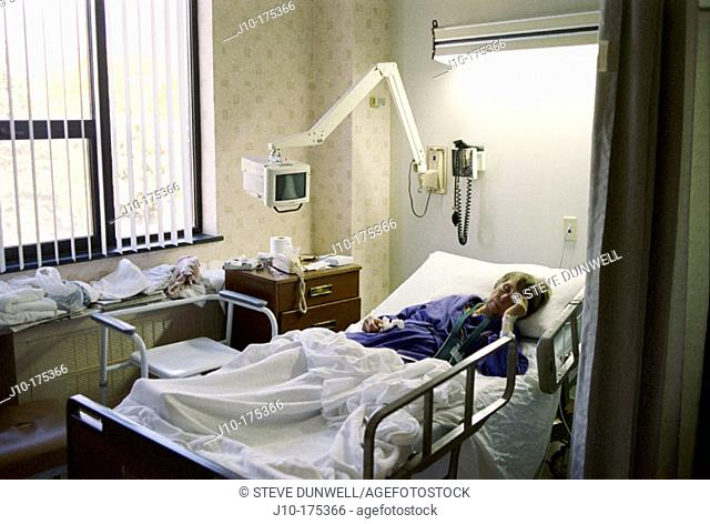Woman age 84 in cardiac hospital ward. Poughkeepsie. New York. USA