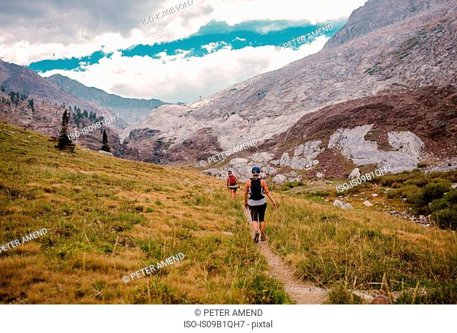 Two women hiking through valley, Mineral King, Sequoia National Park, California, USA