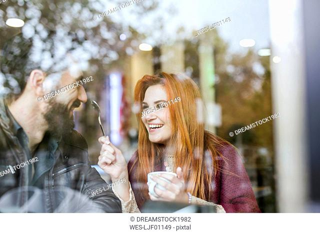 Couple in love having fun together in a coffee shop