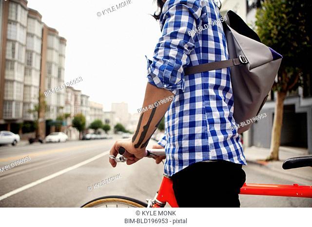 Vietnamese bicycle messenger on city street