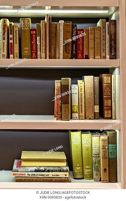 Lighted Bookshelf with Old Books. Atlantic City, NJ, USA