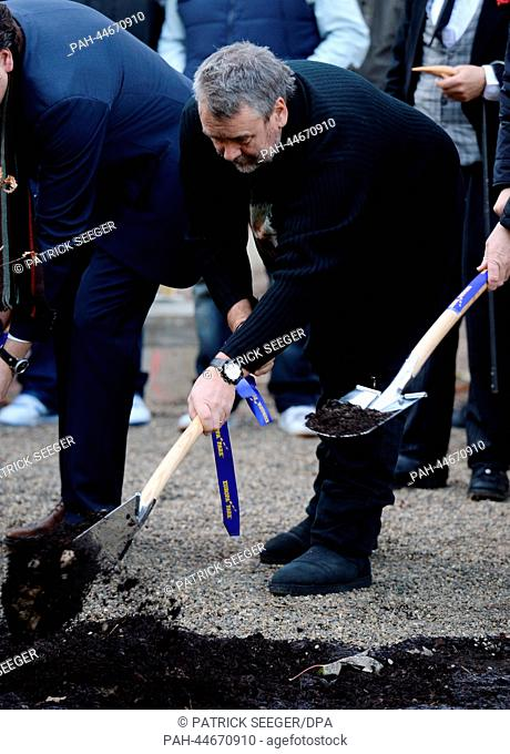 French director Luc Besson plants a tree at Europa Park in Rust, Germany, 09 December 2013. Besson presented the new leisure ride 'Arthut in the Kingdom of the...