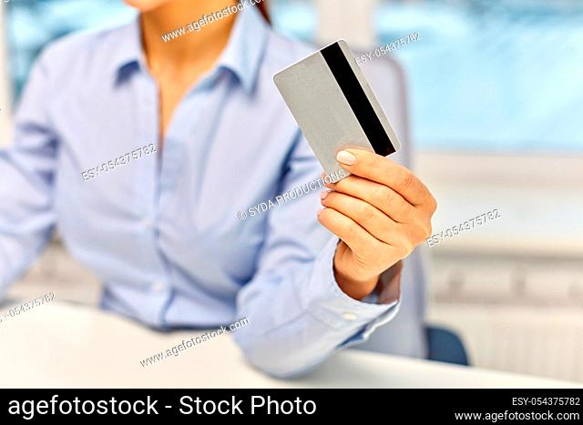 businesswoman with credit card at office