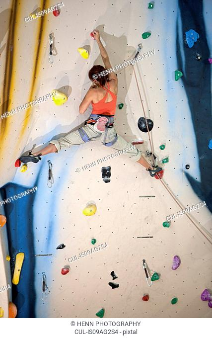 Mature female climber on climbing wall