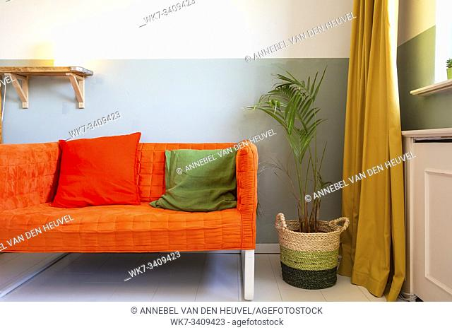 modern room with yellow curtains and orange sofa, colorful Scandinavian design retro
