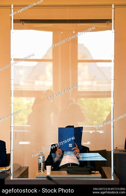 23 July 2020, Hamburg: A 93-year-old former SS guard from the Stutthof concentration camp near Danzig sits in a courtroom behind a Plexiglas screen in the...