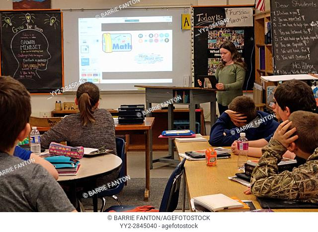 Student Giving Report to Class Using iPad to Apple TV AirPlay, Wellsville, New York, USA