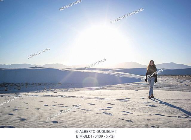 Caucasian woman walking in White Sands National Park, New Mexico, United States