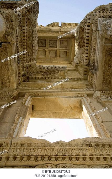 Ephesus. Roman Library of Celsus. View from below looking up at highly carved ceiling and window surround