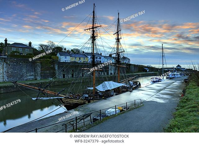 One of the resident tall ships in Charlestown Dock on the south coast of Cornwall, captured at sunrise