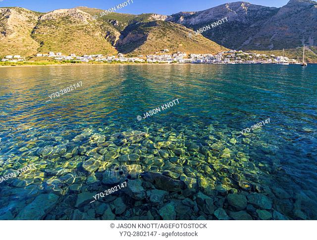 Views over the clean shallow waters of Kamares Bay towards Kamares Town, Sifnos, Cyclades, Greece