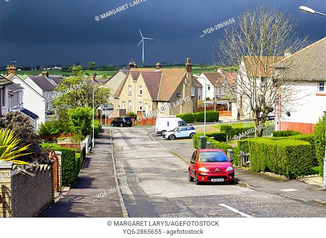 Airdrie, North Lanarkshire, Scotland, UK. Streets of Airdrie during cloudy weather and heavy rain coming changing the weather from very warm and sunny into...