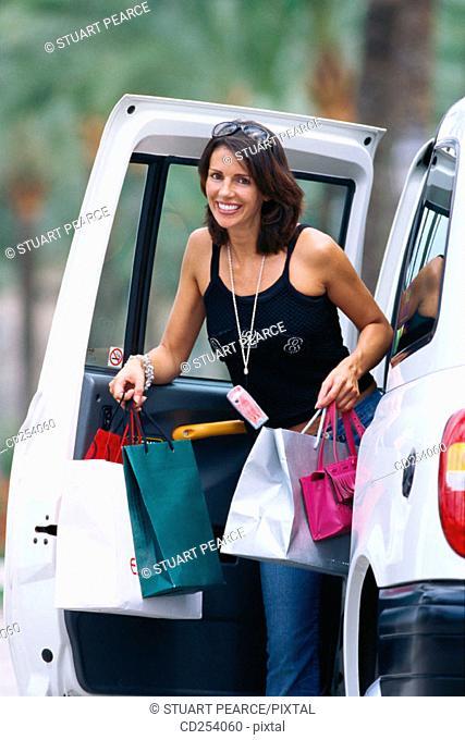 Woman shopping, London Taxi