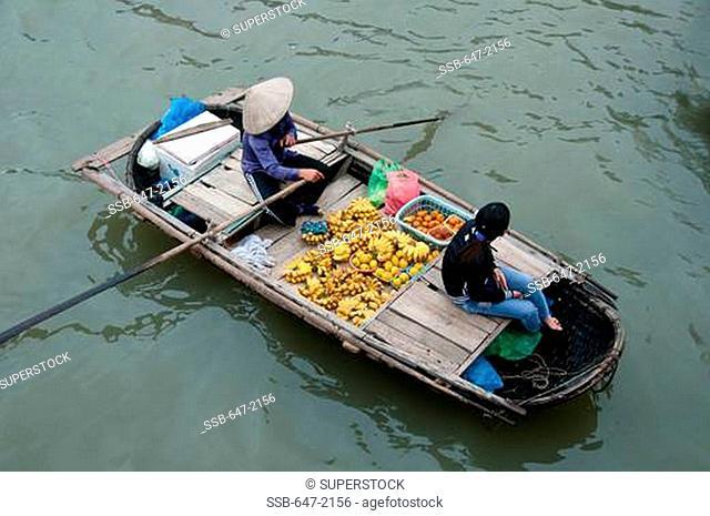 Vendors at a floating market, Ha long Bay, Vietnam